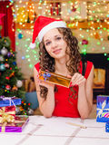 Beautiful girl writing a list of gifts Royalty Free Stock Images