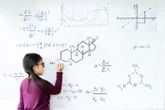 Beautiful girl writing on a whiteboard royalty free stock photo