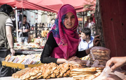 Beautiful girl from Xinjiang selling bread, Shanghai Stock Photography