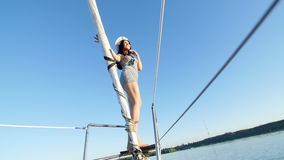 Beautiful girl on a yacht captain - party and bachelorette party.  stock video footage