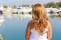Beautiful Girl with yachts Royalty Free Stock Photos