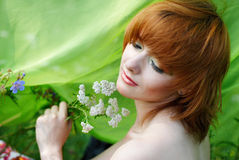 Beautiful girl with yarrow herb Stock Photography