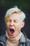Beautiful girl yawns or pain. Beautiful blonde girl yawns or pain Royalty Free Stock Images