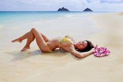 Beautiful girl in a yellow bikini royalty free stock image