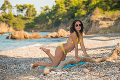 Beautiful girl in yellow bikini Royalty Free Stock Photo
