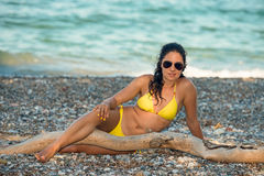 Beautiful girl in yellow bikini Stock Photo