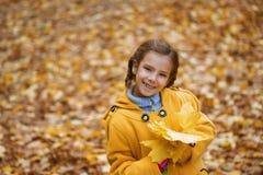Beautiful girl in yellow coat Royalty Free Stock Photography
