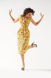 Beautiful girl in a yellow dress dancing Royalty Free Stock Photo