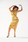 Beautiful girl in a yellow dress dancing Royalty Free Stock Image