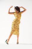Beautiful girl in a yellow dress dancing Royalty Free Stock Photography
