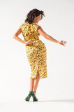 Beautiful girl in a yellow dress dancing Stock Images