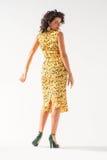 Beautiful girl in a yellow dress dancing Royalty Free Stock Photo