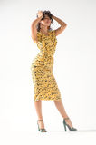 Beautiful girl in a yellow dress dancing Stock Photography