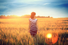 Beautiful girl in yellow field Stock Photo