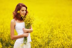 Beautiful girl in the yellow field royalty free stock photo