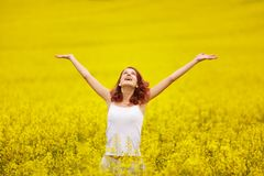 Beautiful girl in the yellow field stock photography