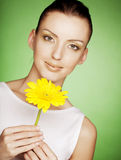 Beautiful girl with yellow flower Royalty Free Stock Image