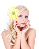 Beautiful girl with yellow flower in hair Royalty Free Stock Photography