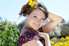 Beautiful girl in the yellow flowers Stock Image