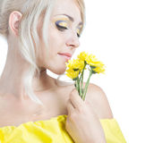 Beautiful girl with yellow flowers. On a white background Stock Image