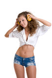 Beautiful girl in yellow headphones Royalty Free Stock Photography