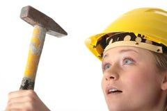Beautiful girl in yellow helmet Stock Images