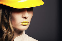 Beautiful girl with yellow helmet Royalty Free Stock Photography