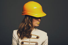 Beautiful girl with yellow helmet Royalty Free Stock Photo