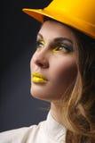 Beautiful girl with yellow helmet portrait Royalty Free Stock Photos