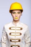 Beautiful girl with yellow helmet portrait Royalty Free Stock Image