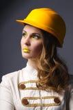 Beautiful girl with yellow helmet portrait Stock Photo