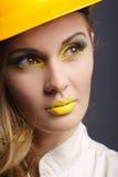 Beautiful girl with yellow helmet portrait Stock Photography
