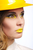 Beautiful girl with yellow helmet portrait Royalty Free Stock Images