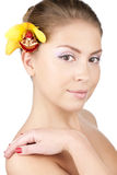 Beautiful girl with a yellow orchid Royalty Free Stock Image