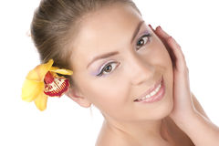 Beautiful girl with a yellow orchid Stock Photo