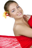 Beautiful girl with a yellow orchid Royalty Free Stock Photo