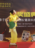 Beautiful girl in yellow performance fan dance Royalty Free Stock Images