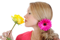 Beautiful girl with a yellow rose. Stock Photos
