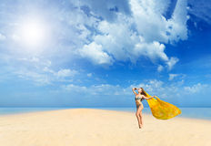 Beautiful Girl With yellow sarong on The Beach. Stock Photos