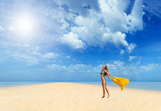 Beautiful Girl With yellow sarong on The Beach. Stock Photo