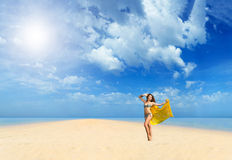 Beautiful Girl With yellow sarong on The Beach. Royalty Free Stock Photo