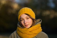 Portrait of young woman in autumn park stock photo