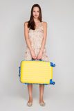 Beautiful girl with a yellow suitcase loves to travel Royalty Free Stock Photo