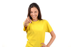 Beautiful girl with yellow t-shirt pointing in front to you. Stock Images