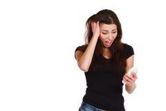 Beautiful girl yells at phone Stock Image