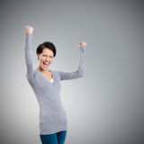 Beautiful girl yes gesturing is happy Stock Photo