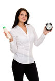 Beautiful girl with yogurt and watches Stock Photography