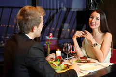 Girl and boy met at restaurant for dinner Stock Photography