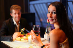 Beautiful girl and boy met at restaurant for dinner royalty free stock image