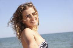 Beautiful girl young  curly hair rejoice relax  holiday sea sunrise Royalty Free Stock Photos